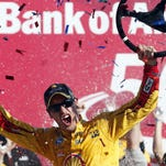 Oct 11, 2015; Concord, NC, USA; Sprint Cup Series driver Joey Logano (22) celebrates winning the Bank of America 500 at Charlotte Motor Speedway. Mandatory Credit: Peter Casey-USA TODAY Sports