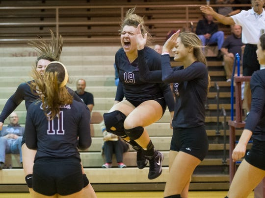 Henderson County's Hannah Hobby (19) celebrates with