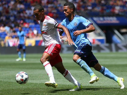 Wappingers Falls' Tyler Adams, hours after graduating from Roy C. Ketcham High School, is pictured keeping the ball away from New York City Football Club midfielder Yangel Herrera for the New York Red Bulls on Saturday in Harrison, New Jersey.