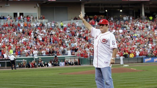 FILE - In this Sept. 11, 2010, file photo, former Cincinnati Reds great Pete Rose stands on first base as he acknowledges the crowd during ceremonies celebrating the 25th anniversary of Rose breaking Ty Cobb's hit record.
