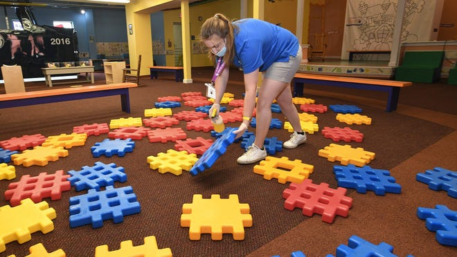 Faith Winkelbauer, 21, cleans waffle blocks Tuesday at the Experience Children's Museum in downtown Erie. It was the first day the museum was open since mid-March, as museum officials developed cleaning and distancing protocols to make the hands-on displays safe for visitors and to slow the spread of COVID-19, the new coronavirus. All the displays are cleaned between museum visiting sessions.