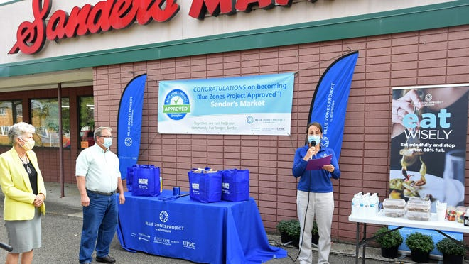 Sander's Market, 826 N. Center St., in Corry, was designated as a Blue Zones-approved grocery store during an event at the store on Monday. From left are: Erie County Executive Kathy Dahlkemper, Sander's Markets co-owner Jake Sander, and Jennifer Eberlein, Blue Zones project manager and organizational lead. The Blue Zones Project is a community awareness initiative that provides information, goals, plans and activities to improve healthy lifestyle choices and nutritional decisions for people who live in the Corry area, which has a high rate of obesity and other negative health factors. The Corry Sander's Market now includes signage about healthier foods that are stocked in the store, as well as nutritious recipes and other information.
