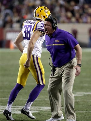 LSU coach Ed Orgeron encourages his players after scoring a touchdown against Texas A&M last week.