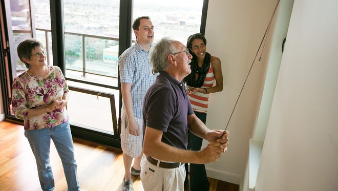Tim Forsman and his fiancee, Michelle Stevens, show Tim's parents, Susan and Ed Forsman, their new condo at the Summit at Copper Square in downtown Phoenix on  May 23, 2014.