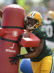 Green Bay Packers defensive tackle Khyri Thornton runs drills during training camp practice at Ray Nitschke Field.