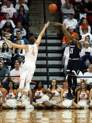 UC's Farad Cobb gets the shot off in the first half Wednesday against Bowling Green.