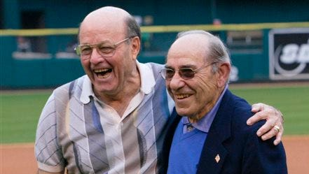 FILE - In this May 31, 2003, file photo, baseball Hall-of-Famers Joe Garagiola, left, and Yogi Berra share a moment after throwing out the first pitch before a game between the Pittsburgh Pirates and St. Louis Cardinals, in St. Louis. Former big league catcher and popular broadcaster Joe Garagiola has died. He was 90. The Arizona Diamondbacks say Garagiola died Wednesday, March 23, 2016. He had been in ill health in recent years.