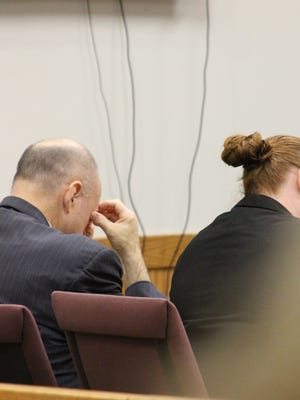 """Martin Edward Zale, left, bows his head as a witness testified at his murder trial Friday in Livingston County Circuit Court that her mind's image of Zale after the Sept. 2 fatal road-rage incident is one of """"pure evil."""" Also pictured is defense attorney Melissa Pearce."""