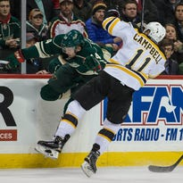 Dec 17, 2014; Saint Paul, MN, USA; Minnesota Wild defenseman Justin Falk (44) hits Boston Bruins forward Gregory Campbell (11) during the first period at Xcel Energy Center. Mandatory Credit: Brace Hemmelgarn-USA TODAY Sports