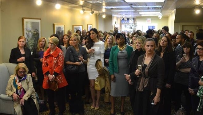 People gather for the opening party organized for Dress for Success Rochester, which opened downtown at 47 State St.