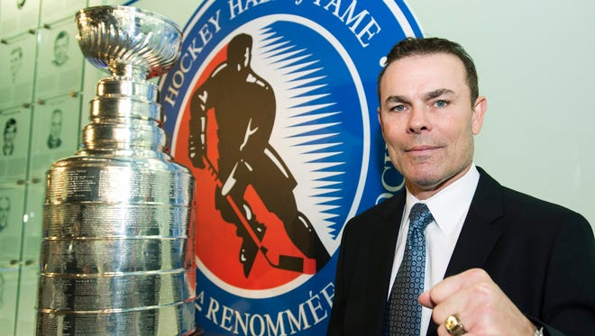 Hockey Hall of Fame inductee Adam Oates poses for a photograph at the Hockey Hall of Fame in Toronto on Monday, Nov. 12, 2012.