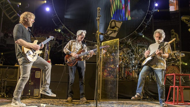 Princeton native Trey Anastasio (from left), Phil Lesh and Bob Weir of the Grateful Dead perform at Chicago's Soldier Field on July 4, 2015, in this photo by Jay Blakesberg of Clark.