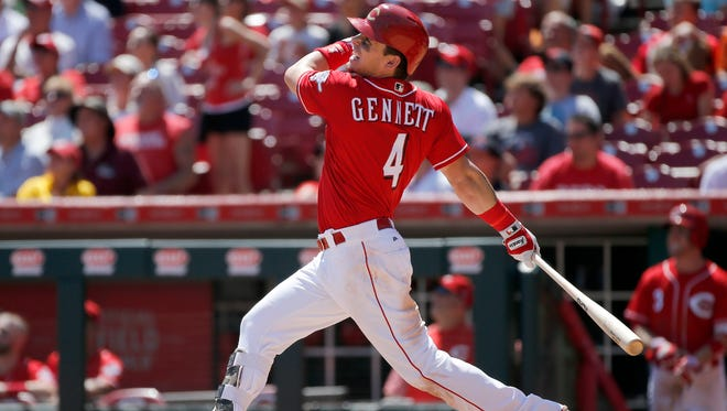 Cincinnati Reds second baseman Scooter Gennett  follows through as he hits a grand slam to take the lead for the Reds in the bottom of the seventh inning of their MLB National League game against the San Diego Padres at Great American Ball Park in downtown Cincinnati on Thursday, Aug. 10, 2017.