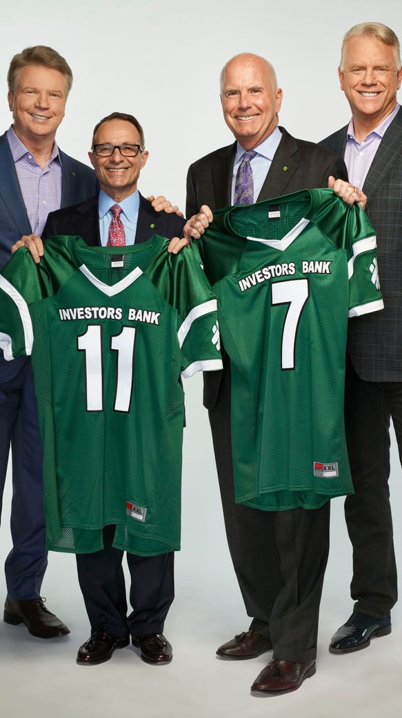 Phil Simms and Boomer Esiason with executives of Investors