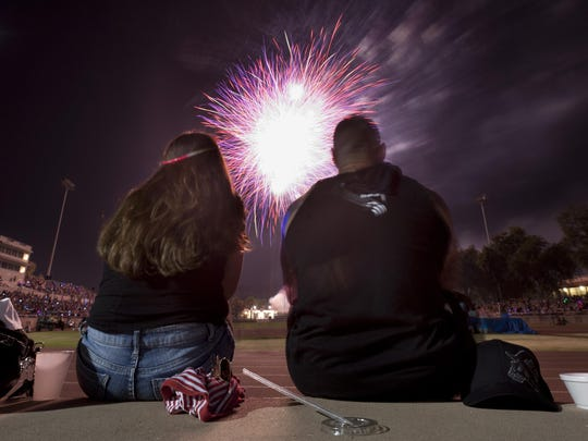 In this archive photo, Lena Marroquin, left, and Claude Cannon watch the 2014 4th of July Freedom Celebration featuring fireworks, entertainment at Giant Chevrolet-Cadillac Mineral King Bowl.