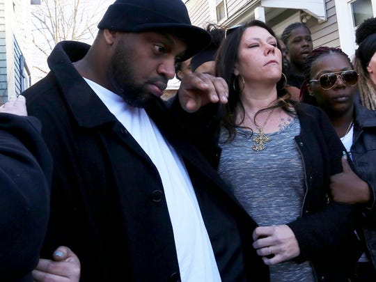 Tony Robinson, Sr. and Andrea Irwin, parents of Tony Robinson, appear Monday, March 9, 2015 during a press conference outside the home where their 19-year-old son was killed by a Madison, Wis. police officer several days earlier.