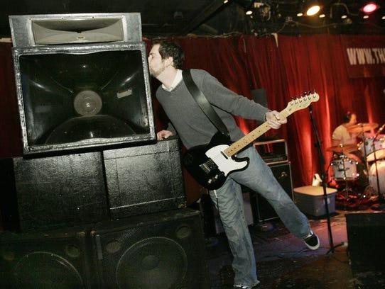 Lunar Event vocalist-guitarist Derek Osgood playfully