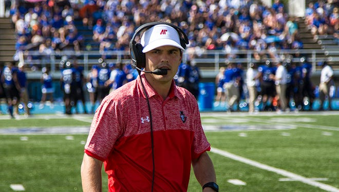 First year coach Will Healy prowls the sidelines at the EIU game on Saturday, Sept. 24.
