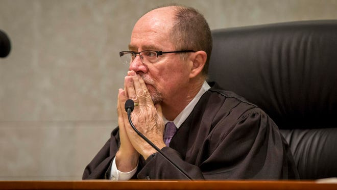 Justice Daryl L. Hecht listens to lawyers during oral arguments on the Planned Parenthood v. Reynolds case at the Iowa Supreme Court Wednesday, Feb. 14, 2018, in Des Moines, Iowa.