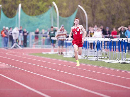 Champlain Valley's Tyler Marshall is all alone down the home stretch en route to winning the boys 1,500 meters in state-record time at the Burlington Invitational track meet on Saturday at D.G. Weaver Athletic Complex. Marshall finished in 3:56.18.