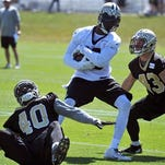 New Orleans Saints wide receiver Brandon Coleman (16) pulls in pass with New Orleans Saints defensive back Delvin Breaux (40) and New Orleans Saints safety Vinnie Sunseri (43) trying to defend the play during the teams NFL football training camp in White Sulphur Springs, W. Va.
