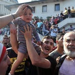 A Syrian refugee argues with Turkish security Sept. 15 as hundreds of people trying to reach Europe have gathered at a central bus station in Istanbul.