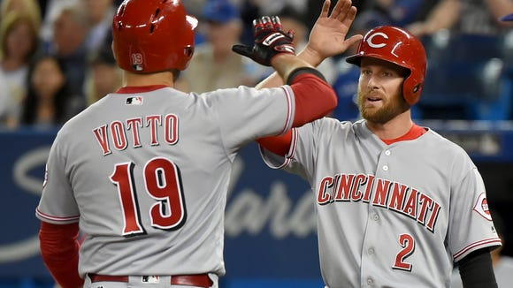 The Reds' Zack Cozart isn't exactly sure what he'll do with the donkey Joey Votto is buying him