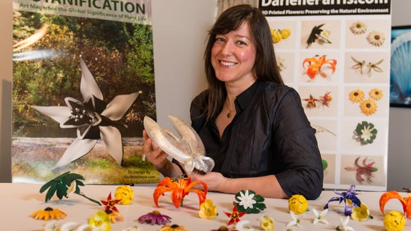 Darlene Farris-LaBar  with some of her 3-D printed works. (Photo courtesy of Darlene Farris-LaBar)
