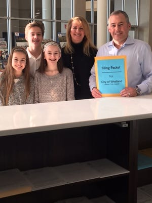 Westland Mayor William Wild filed to run for reelection. Joining him at city hall are children Payton (left), Luke, Lily and wife Sherri.
