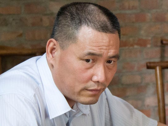 Human rights lawyer Pu Zhiqiang works near his computer