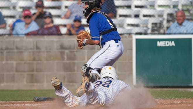 Moody's Matt Villanueva slides in to home  during the second inning of the 5A Regional semifinal's third game against Kerrville Tivy at Cabaniss Baseball Field on Saturday, May 27, 2017.