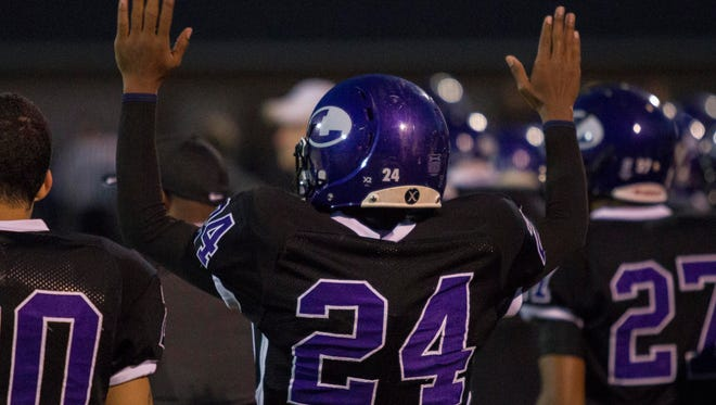 Dashone Asberry of Lakeview puts his hands in the air to celebrate a Lakeview touchdown against Loy Norrix.