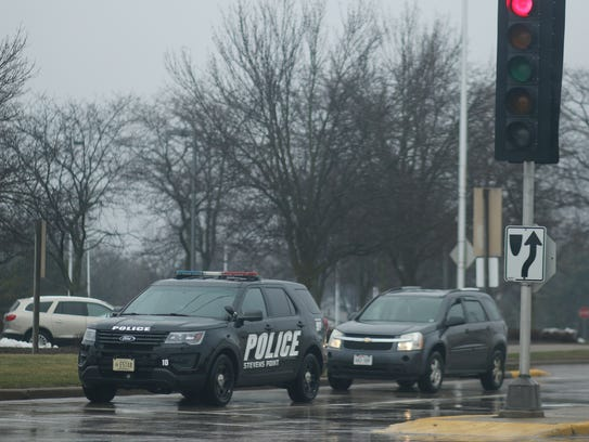 A Stevens Point police vehicle sits at the intersection