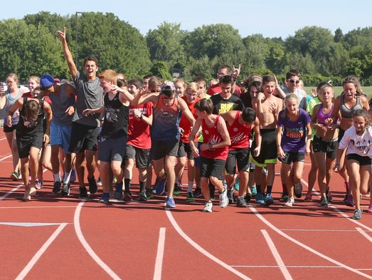 The entire Penfield cross country team runs across