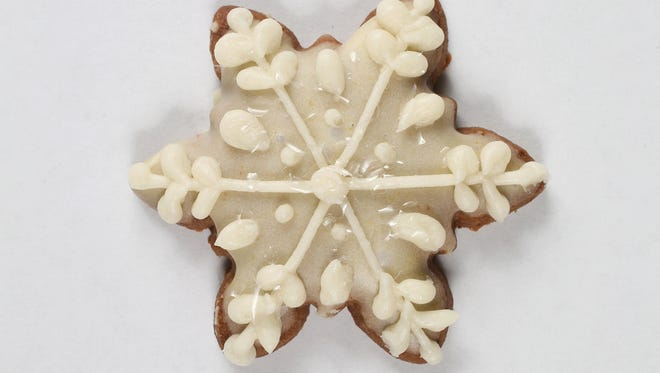 Oranginger Snap Snowflake Cookies are pretty and tasty.