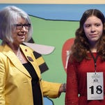 Presbyterian Christian School's Sarah Spencer is Mississippi's 2016 Spelling Bee champion.  She is congratulated by Mississippi Association of Educators President Joyce Helmick.