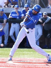 UK's Tristan Pompey (6) knocks in two runs against Louisville in the second inning of their game in Lexington.    