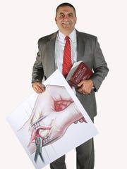 Fort Myers attorney Carlos Cavenago lll displays an