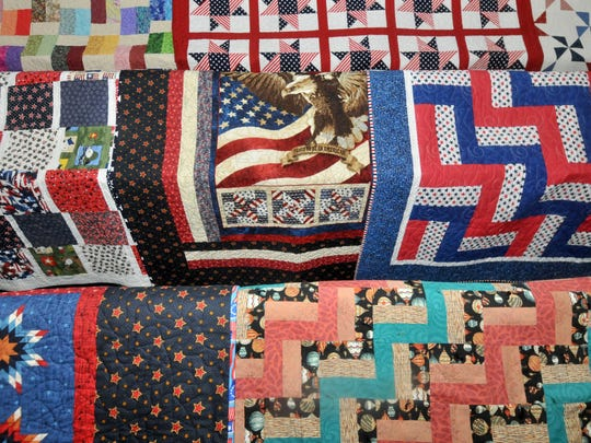 The Berry Basket Quilters at Medford Leas Community Center in Medford presented quilts to returning airmen from Joint Base Mcguire-Dix-Lakehurst in Medford, N.J.
