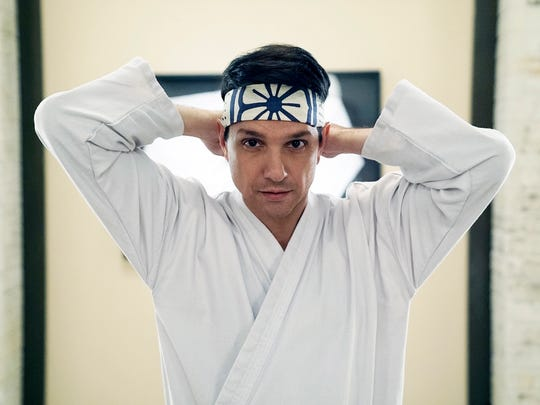 Ralph Macchio dons familiar headwear as Daniel LaRusso