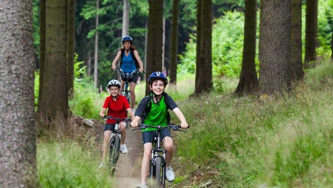 Family biking on trails