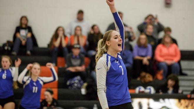 Croswell-Lexington's Lexie Davidson celebrates during a volleyball game Thursday, Oct. 27, 2016 at Armada High School.