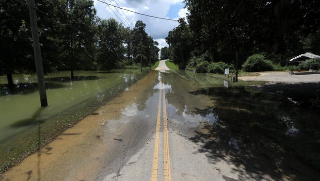 Residents near the Canopy at Welaunee property have seen on overflow of storm water out on to the adjacent Fleischmann Lane, seen here flooded three days after the last heavy rain.