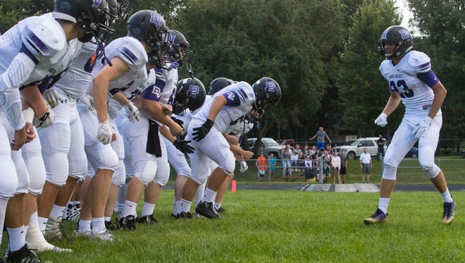 Dakota Valley High School players get excited before the game against Dell Rapids on Friday, Aug. 24, 2018 at Dell Rapids High School.