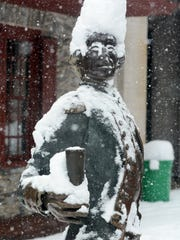 The Lafayette statue outside the Golden Plough Tavern tells the story of the past two days snowfall Wednesday, March 21, 2018. Bill Kalina photo