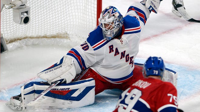 Rangers goalie Henrik Lundqvist stops a shot from Canadiens defenseman Andrei Markov (79) during the third period of Game 2.
