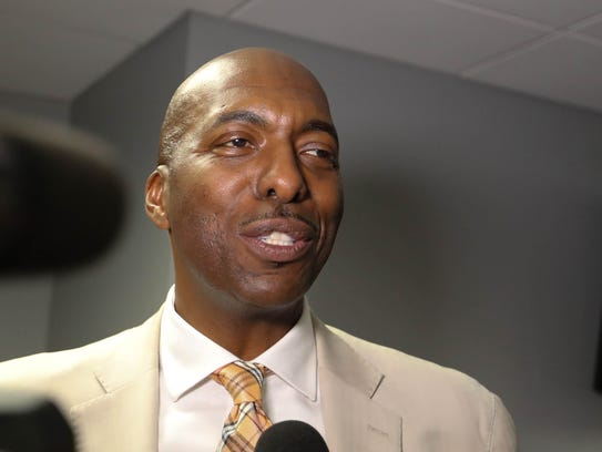 Former Pistons forward John Salley talks with reporters