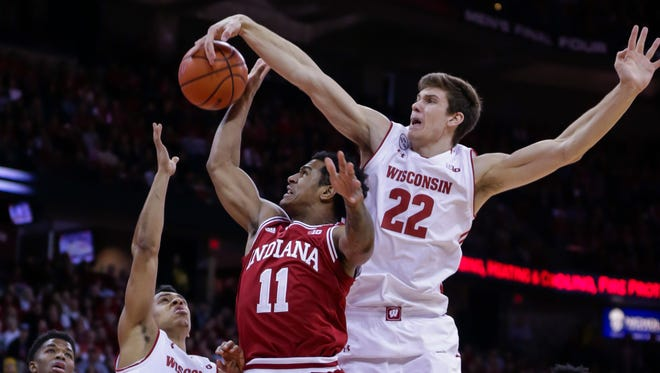 Wisconsin's Ethan Happ (22) with help from D'Mitrik Trice defends Indiana's Devonte Green during their game Sunday at the Kohl Center.