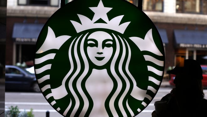 In this Saturday, May 31, 2014 photo, the Starbucks logo is seen at one of the company's coffee shops in downtown Chicago.