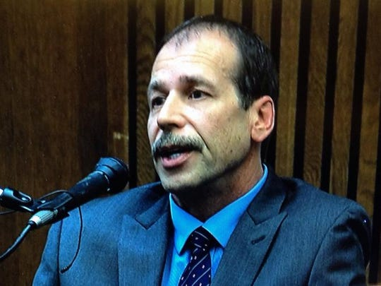 Theodore Wafer takes the stand in his own defense in his murder trial Monday, Aug. 4, 2014, at the Frank Murphy Hall of Justice in Detroit.